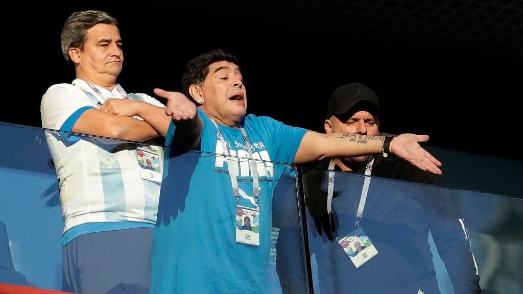 Argentina former soccer star Diego Maradona waves to the fans ahead of the Group D match between Argentina and Nigeria at the St. Petersburg Stadium on Tuesday.