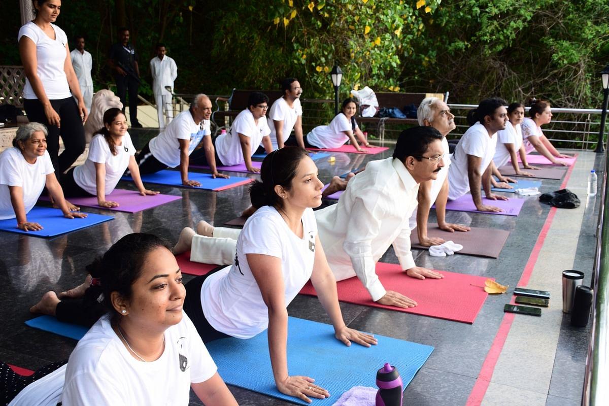 Maharashtra Governor C Vidyasagar Rao practices yoga 'asans' (postures) on the Fourth International Yoga Day at Raj Bhawan in Mumbai.