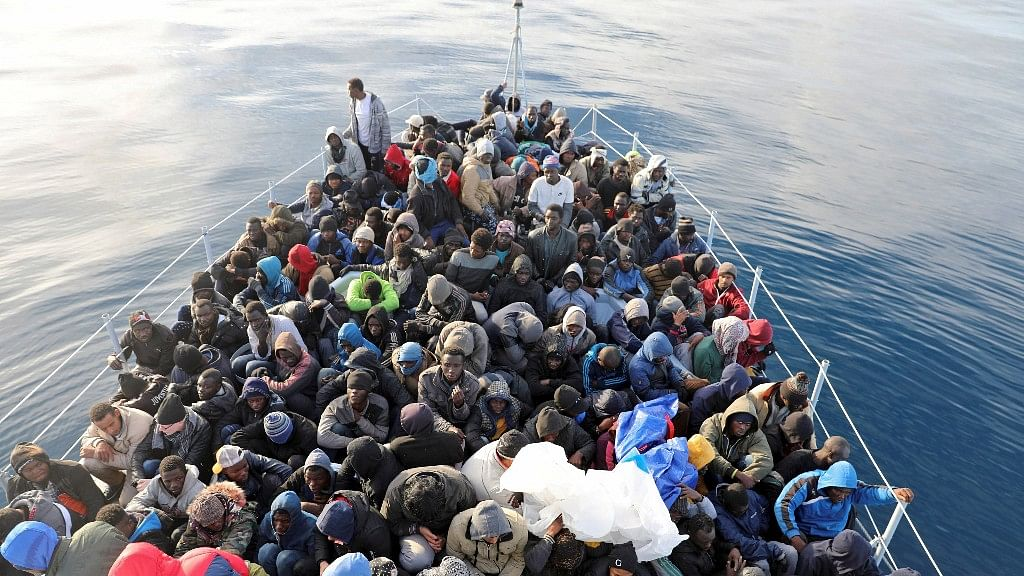 Migrants are seen in a boat as they are rescued by Libyan coast guards in the Mediterranean Sea.