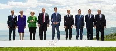 LA MALBAIE, June 8, 2018 (Xinhua) -- Participants of the Group of Seven (G7) summit European Union Council President Donald Tusk, British Prime Minister Theresa May, German Chancellor Angela Merkel, U.S. President Donald Trump, Canadian Prime Minister Justin Trudeau, French President Emmanuel Macron, Japanese Prime Minister Shinzo Abe, Italian Prime Minister Giuseppe Conte and European Commission President Jean-Claude Juncker (from L to R) pose for a group photo on the first day of the G7summit
