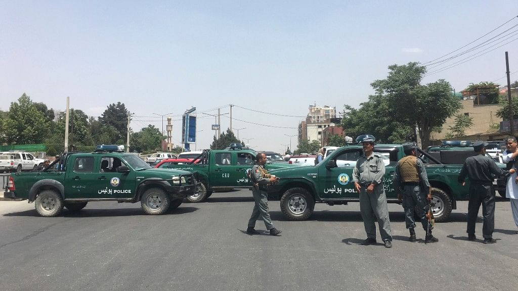 Security personnel block the road after a suicide attack in Kabul, Afghanistan, 4 June, 2018.
