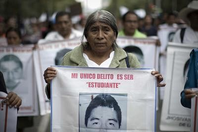 """MEXICO CITY, Aug. 27, 2015 (Xinhua) -- A relative takes part in the march for the eleven months of the disappearance of 43 students of the Normal Rural School """"Raul Isidro Burgos"""" of Ayotzinapa, state of Guerrero, in Mexico City, capital of Mexico, on Aug. 26, 2015. Relatives of the missing students took part in a march on Wednesday, one month before the first anniversary of their disappearance. (Xinhua/Alejandro Ayala/IANS)"""