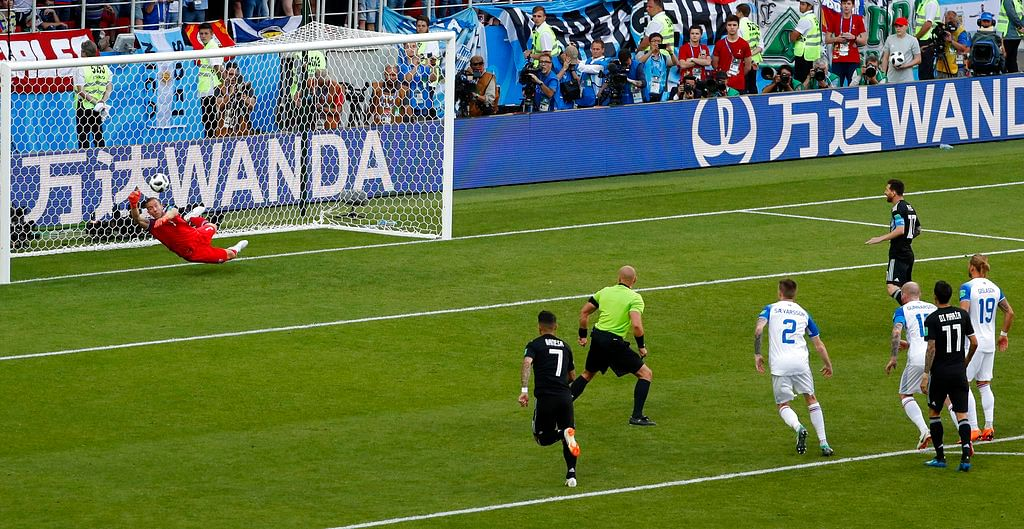 Iceland goalkeeper Hannes Halldorsson dives to save Lionel Messi's penalty in his country's first ever World Cup game