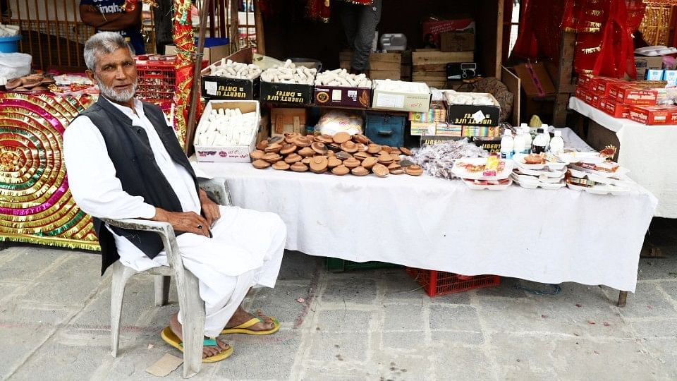 Muhammed Ashraf sells prayer items inside the temple compound.