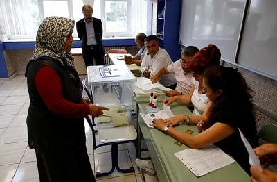 ANKARA, June 24, 2018 (Xinhua) -- A woman registers for voting during the presidential and parliamentary elections at a polling station in Ankara June 24, 2018. Turkey held presidential and parliamentary elections on Sunday. (Xinhua/Qin Yanyang/IANS)