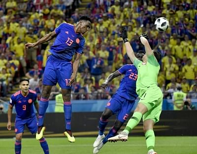 KAZAN, June 24, 2018 (Xinhua) -- Yerry Mina (top) of Colombia heads the ball to score during the 2018 FIFA World Cup Group H match between Poland and Colombia in Kazan, Russia, June 24, 2018. (Xinhua/He Canling/IANS)