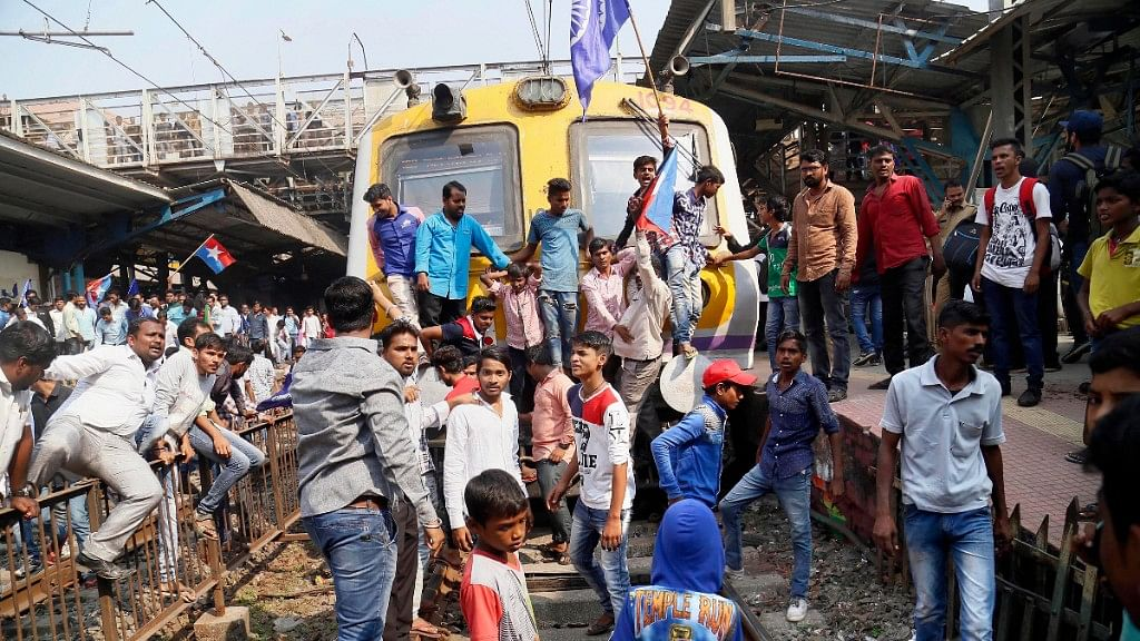 Dalit groups protesting at Thane railway station during the Maharashtra Bandh on 3 January following clashes between two groups in Bhima Koregaon near Pune.