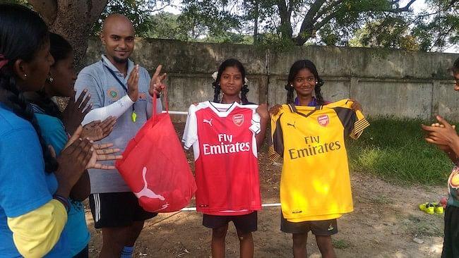 Chamundeswari and Anbarasi with their jerseys.