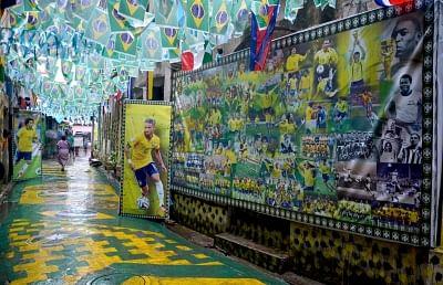 Kolkata: A Sonagachi lane decorated with Brazilian flags and a collage of footballers as FIFA fever grips Kolkata, on June 25, 2018. (Photo: Kuntal Chakrabarty/IANS)