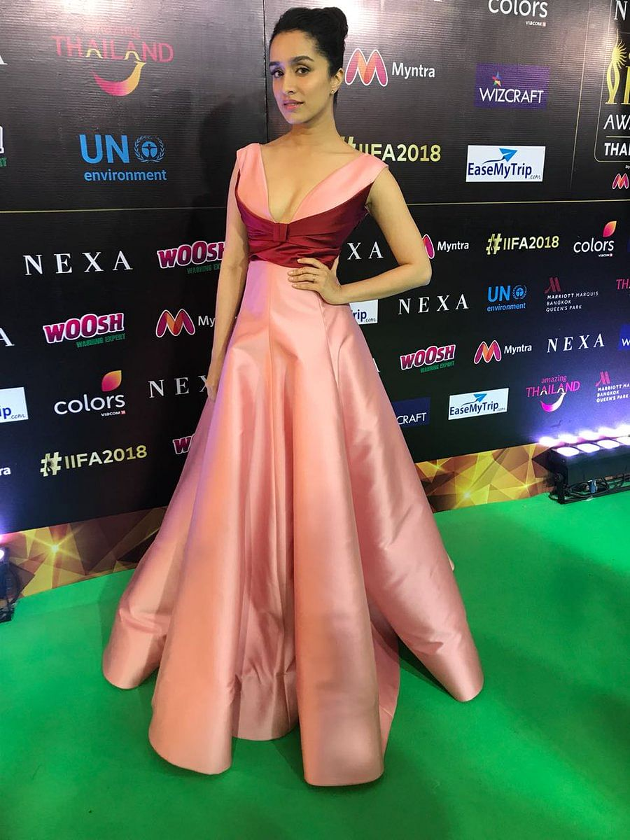 Shraddha Kapoor in a satin bow-neck gown at the IIFA 2018 green carpet.