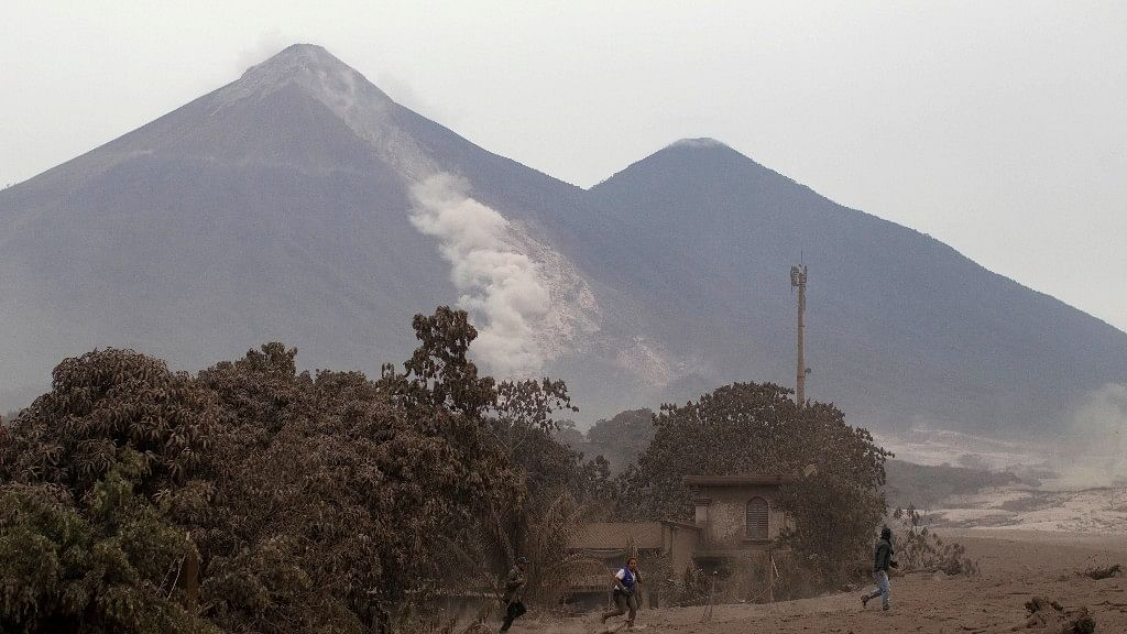 The Volcan de Fuego, or Volcano of Fire, continues to spill out smoke and ash as residents evacuate Escuintla, Guatemala, Monday, 4 June.