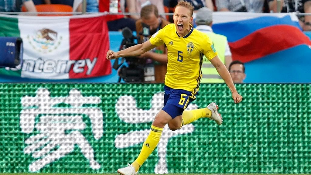 Sweden's Ludwig Augustinsson celebrates after scoring his side's first goal during their Group F match against Mexico at the Yekaterinburg Arena on Wednesday.