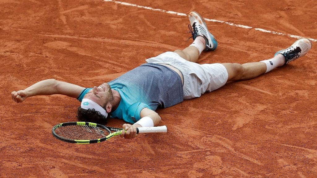 Italy's Marco Cecchinato celebrates winning his quarterfinal match of the French Open tennis tournament against Serbia's Novak Djokovic at the Roland Garros stadium in Paris on Tuesday.