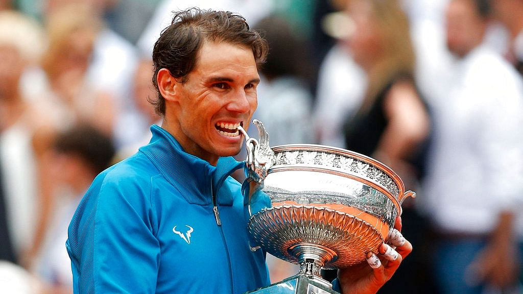 Rafael Nadal poses with the French Open trophy for the eleventh time.