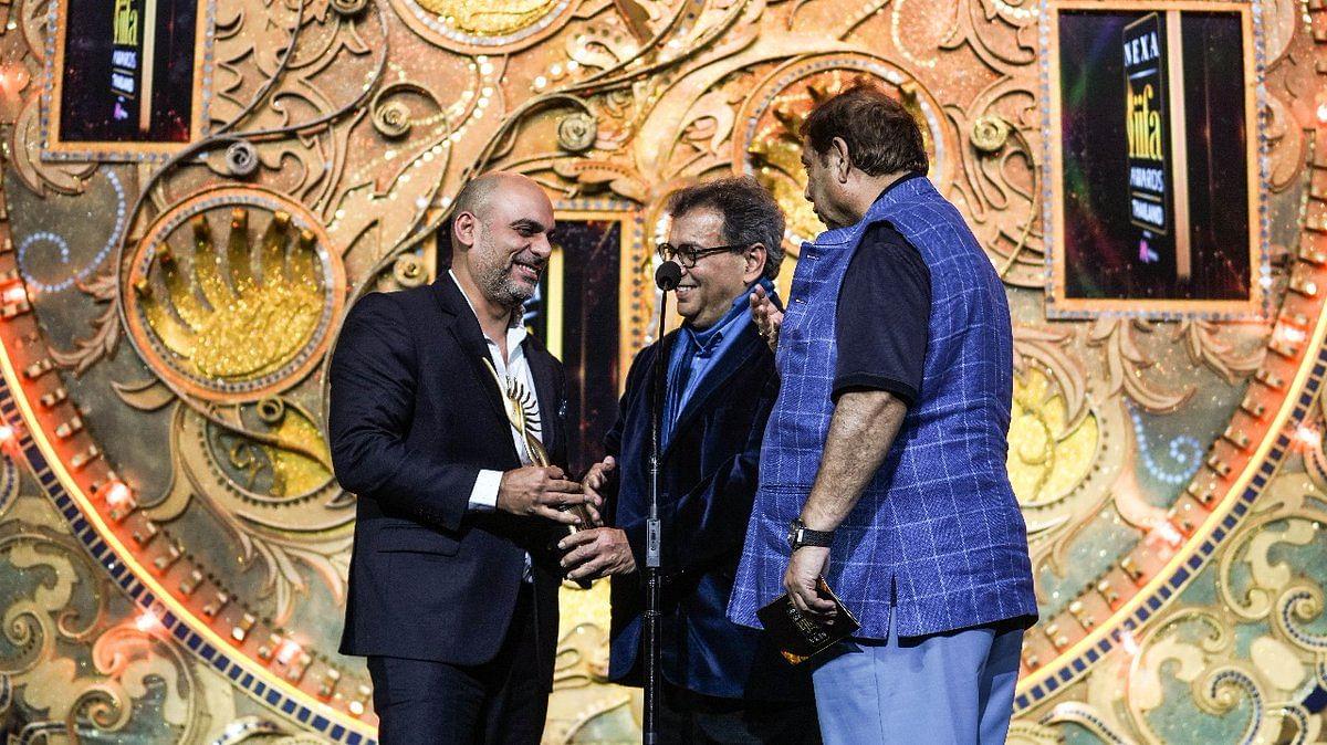 David Dhawan and Subhash Ghai present the award for Best Direction Award to Saket Chaudhary for 'Hindi Medium'