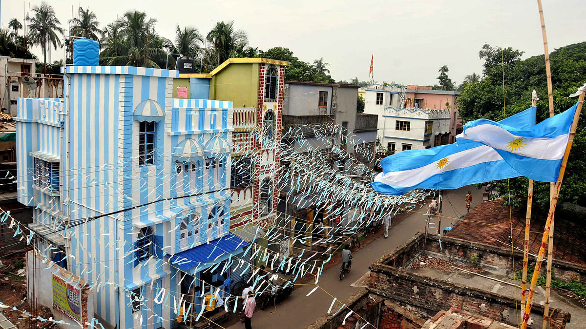 A view of tea-seller and die-hard Lionel Messi fan, Shib Shankar Patras three-storeyed apartment painted in blue-and-white ahead of FIFA World Cup 2018.