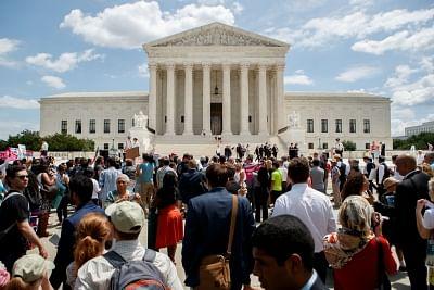 WASHINGTON, June 26, 2018 (Xinhua) -- People gather to protest Supreme Court