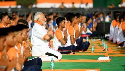 Dehradun: Prime Minister Narendra Modi practices yoga asanas (postures) on the Fourth International Yoga Day at Forest Research Institute (FRI) in Dehradun on June 21, 2018. (Photo: IANS/PIB)