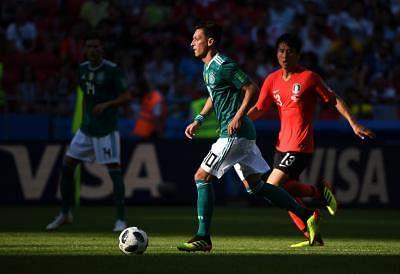 KAZAN, June 27, 2018 (Xinhua) -- Mesut Oezil (L) of Germany competes during the 2018 FIFA World Cup Group F match between Germany and South Korea in Kazan, Russia, June 27, 2018. (Xinhua/Li Ga/IANS)