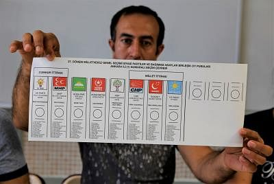 ANKARA, June 24, 2018 (Xinhua) -- A worker shows the ballot of parliamentary election at a polling station in Ankara June 24, 2018. Turkey held presidential and parliamentary elections on Sunday. (Xinhua/Qin Yanyang/IANS)