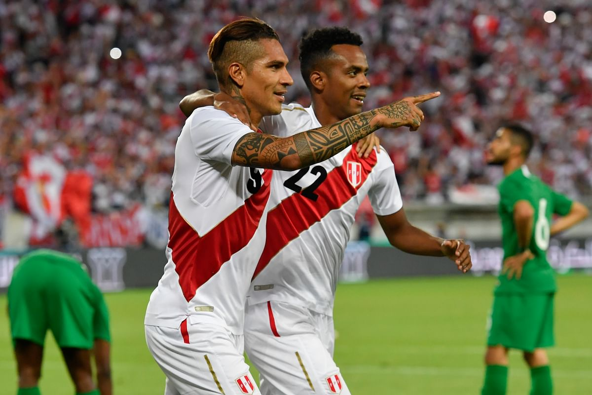Peru's Paolo Guerrero, and Pedro Aquino, from left, react after Guerrero scored during a friendly soccer match between Saudi Arabia and Peru.