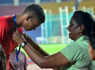 Guwahati: Former sprinter PT Usha presents the silver medal for 5000-meter run to Uttar Pradesh