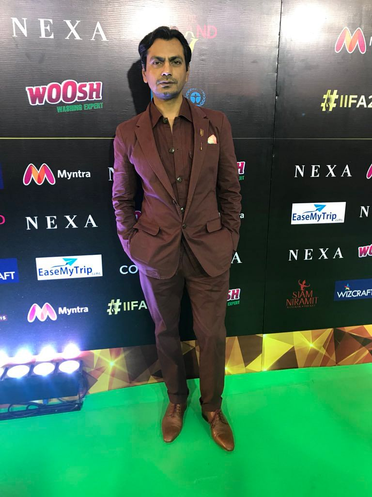 Nawazuddin Siddique chooses a maroon suit and brown shoes for the event.