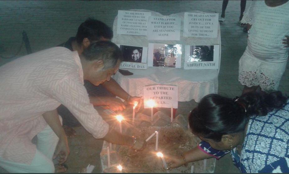 Residents of Pragati Nagar and Ganapati,  Lal Ganesh conduct a candle night march.