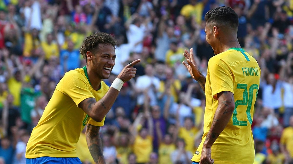 Brazil's Roberto Firmino, right, celebrates with team mate Neymar after scoring his side's second goal.