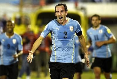 MONTEVIDEO, Oct. 14, 2015 (Xinhua) -- Diego Godin of Uruguay celebrates scoring during Round 1 Group 1 match of 2018 World Cup South American Montevideo, June 10 (IANS) Uruguay