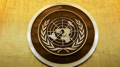 Plaque bearing the United Nations logo above the podium of the General Assembly Hall. Image used for representation only.