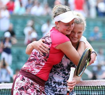 PARIS, June 8, 2018 (Xinhua) -- Barbora Krejcikova (L) and Katerina Siniakova of the Czech Republic celebrate victory after winning the women