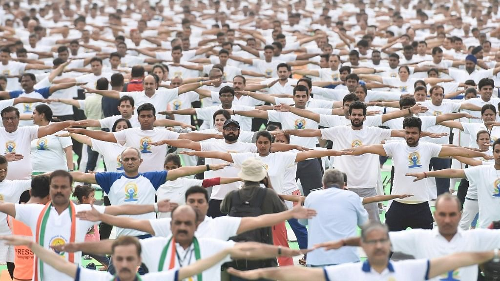 Volunteers practice yoga during a mass  session on the 4th International Yoga Day in New Delhi. Image used for representational purposes only.