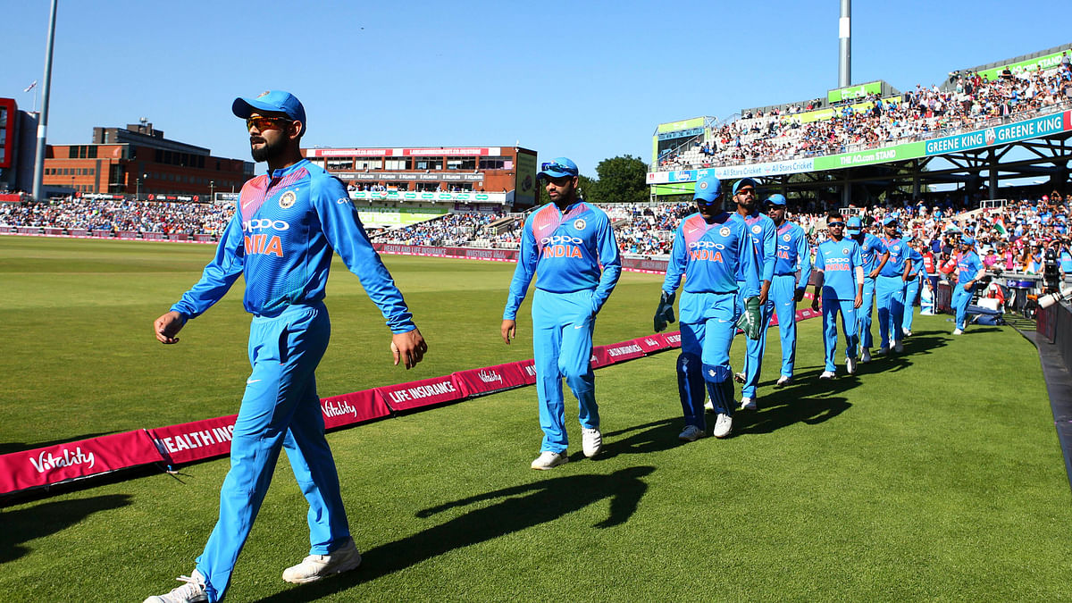 Virat Kohli leads his team onto the field for the first T20 against England.