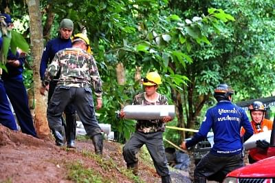 CHIANG RAI, July 3, 2018 (Xinhua) -- Rescuers search for the 12 teenagers and their football coach who went missing in Mae Sai, Chiang Rai province, in northern Thailand, July 2, 2018. Twelve teenagers and their football coach, trapped in a cave in northern Thailand for nine days, have been found alive on Monday night, Narongsak Osottanakorn, governor of Chiang Rai province said. (Xinhua/Rachen Sageamsak/IANS)