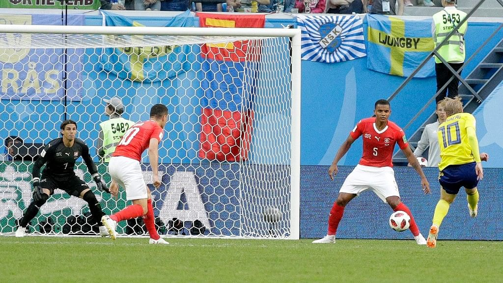 Sweden's Emil Forsberg (right) scores the opening goal  during their Round of 16 match against Switzerland at the St. Petersburg Stadium on Tuesday.
