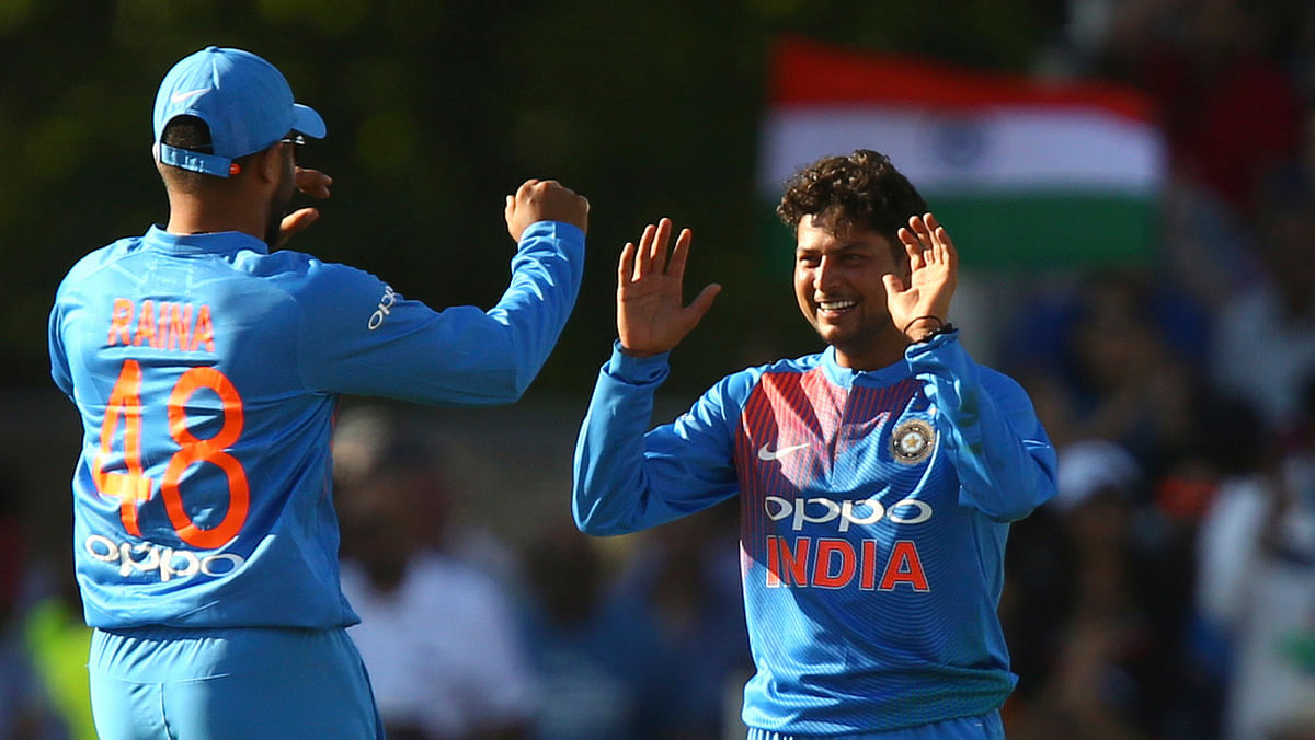 India's Kuldeep Yadav, left, celebrates with India's Suresh Raina after taking the wicket of England's Jonny Bairstow during the Twenty20 cricket match between England and India at Old Trafford cricket ground in Manchester, England, Tuesday, July 3, 2018.