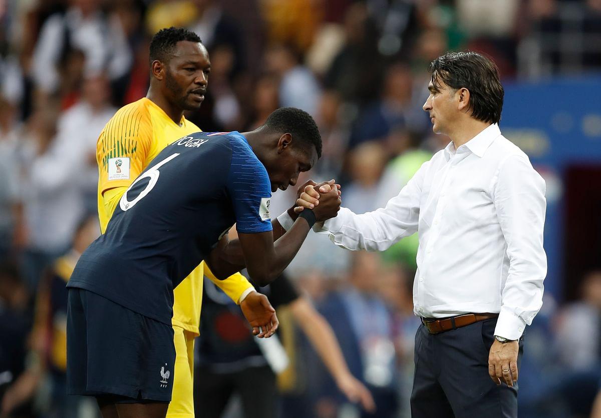France's Paul Pogba, left shakes hands with Croatia head coach Zlatko Dalic after France defeated Croatia.