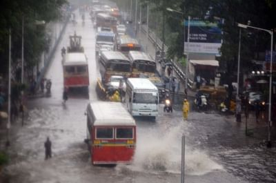 Mumbai: Vehicles move through the flooded Dadar TT Circle during heavy rains, in Mumbai on July 10, 2018. (Photo: IANS)