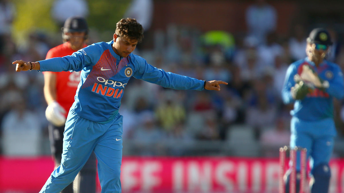Kuldeep Yadav celebrates taking a fifer against England in the first T20 at Old Trafford.