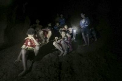 CHIANG RAI (THAILAND), July 3, 2018 (Xinhua) -- Photo provided by Thai Navy Seal shows trapped teenagers in a cave in Mae Sai, Chiang Rai province, northern Thailand, on July 2, 2018. Twelve teenagers and their football coach, trapped in a cave in northern Thailand for nine days, have been found alive on Monday night, Narongsak Osottanakorn, governor of Chiang Rai province said. (Xinhua/IANS)