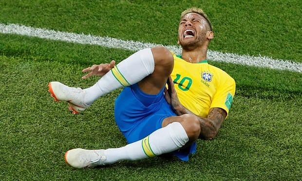 Neymar grimaces with pain.