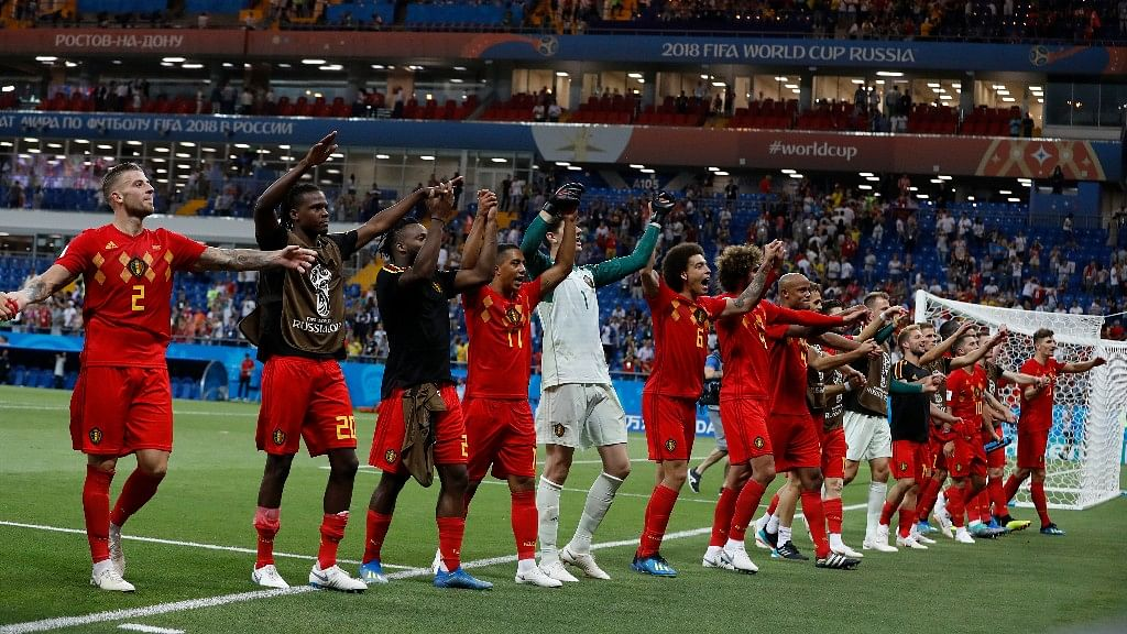 The Belgium team celebrates with fans after its last gasp win over Japan