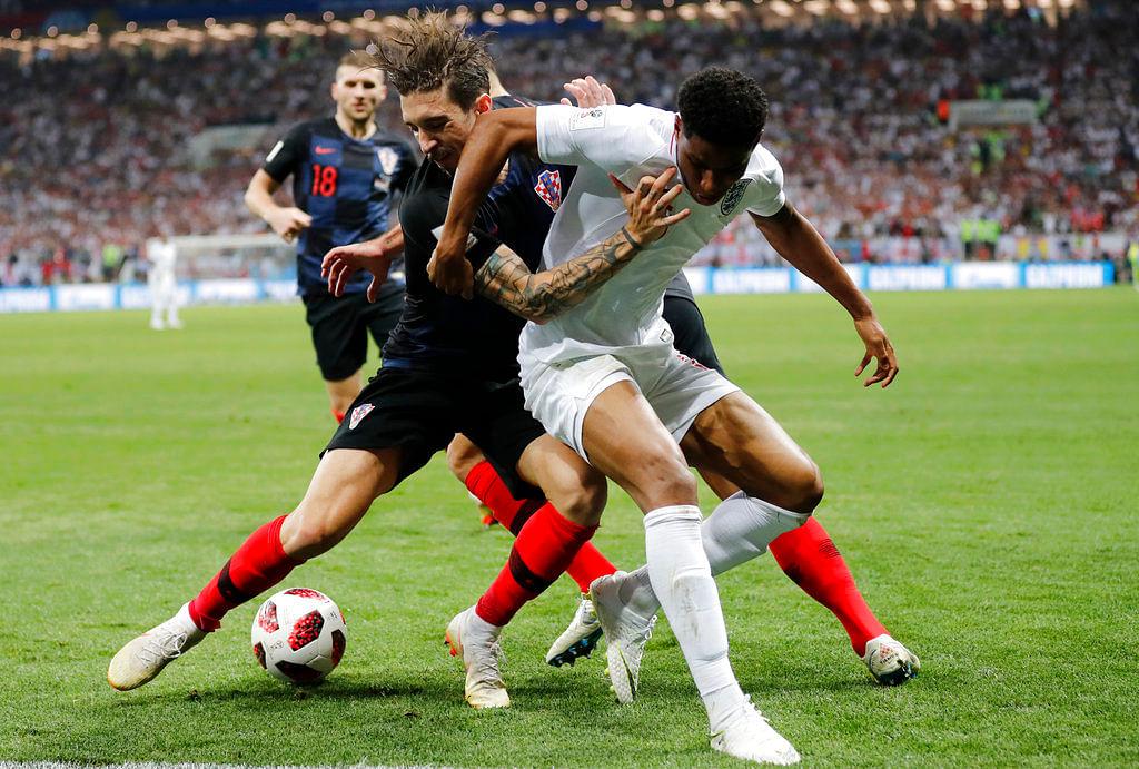 England's Marcus Rashford, right, and Croatia's Sime Vrsaljko challenge for the ball.