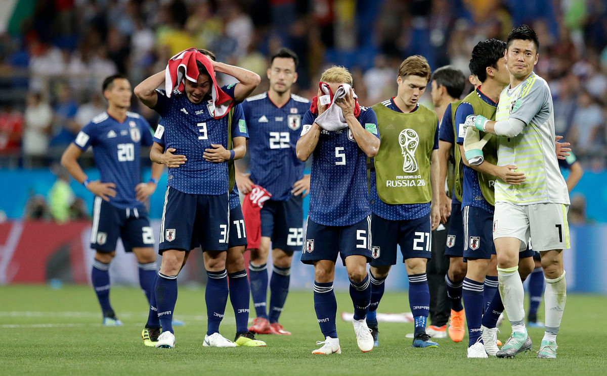 Japan's  players walk off the pitch after losing their Round of 16 match against Belgium at Rostov Arena on Monday.