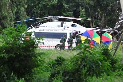 CHIANG RAI, July 10, 2018 (Xinhua) -- An evacuation helicopter and an ambulance are seen in Mae Sai district of Chiang Rai province, Thailand, July 10, 2018. All 12 boys and their football coach have been rescued from a flooded cave in northern Thailand after being trapped for 18 days, Thai navy SEALs confirmed on Tuesday. (Xinhua/Rachen Sageamsak/IANS)
