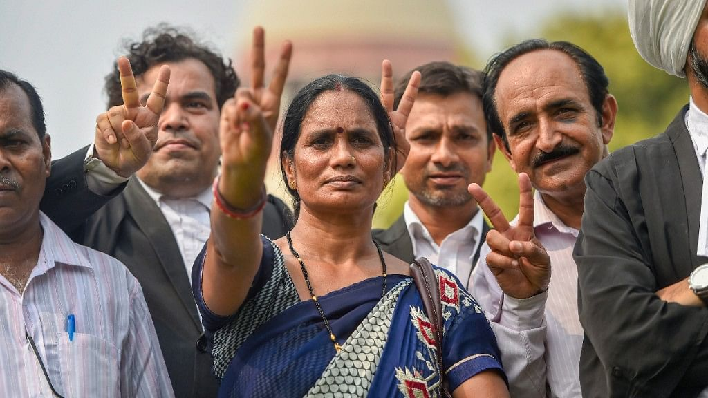 Nirbhayas parents show victory sign after the Supreme Courts verdict on Dec 2012 gang rape case, in New Delhi on Monday, July 9, 2018.