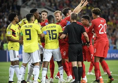 MOSCOW, July 3, 2018 (Xinhua) -- Players of England and Colombia clash during the 2018 FIFA World Cup round of 16 match between England and Colombia in Moscow, Russia, July 3, 2018. (Xinhua/Lui Siu Wa/IANS)