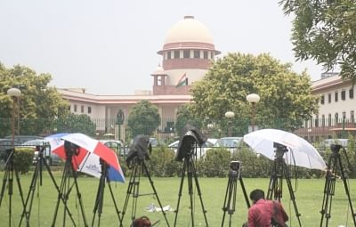 New Delhi: Media persons wait outside the Supreme court during the hearing on petitions against Section 377 of the Indian Penal Code that makes homosexuality a crime; in New Delhi on July 10, 2018. (Photo: IANS)