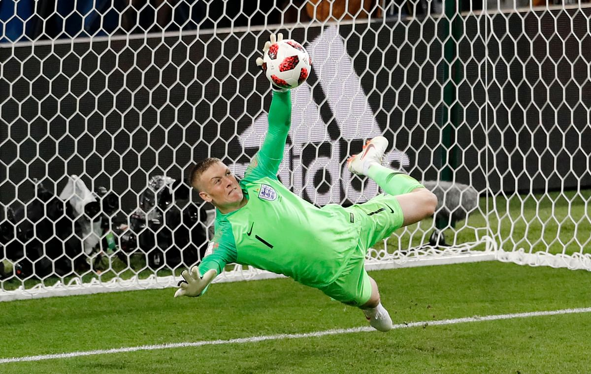 England goalkeeper Jordan Pickford stops a penalty shot from Colombia's Carlos Bacca during their Round of 16 match at the  Spartak Stadium on Tuesday.